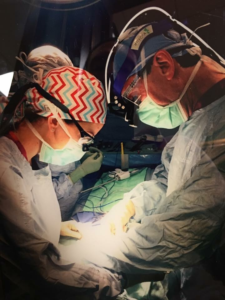 Dr Gary Clayman in the operating room doing a thyroid surgery.